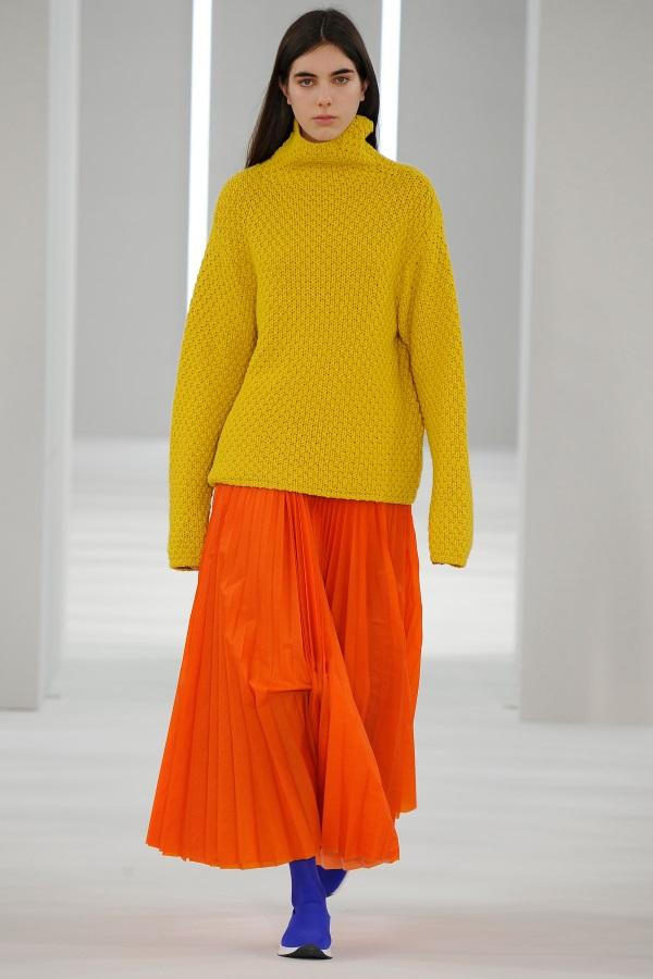 Jasper Conran AW18: Sulphur Yellow cashmere moss stitch knit, Antarctic orange sunray pleat skirt