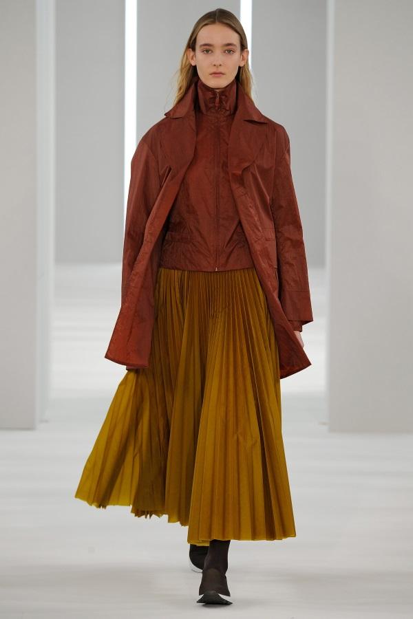 Jasper Conran AW18: Conker brown Overcoat, conker brown funnel neck jacket, ochre sunray pleat skirt
