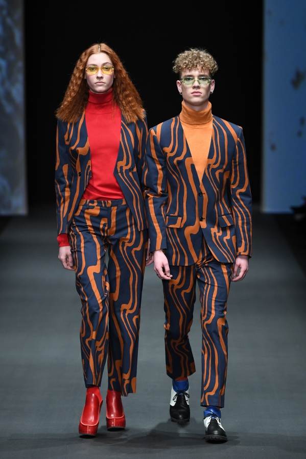 Suits by Rhumaa, turtlenecks by Ivanman, glassws by Vintage, shoes by Trippen. NEONYT AW19/20. <br /> Photograph: John Phillips/Getty Images for NEONYT